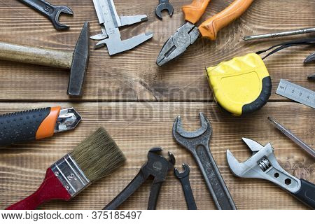Labor Day. Various Tools On A Wooden Table