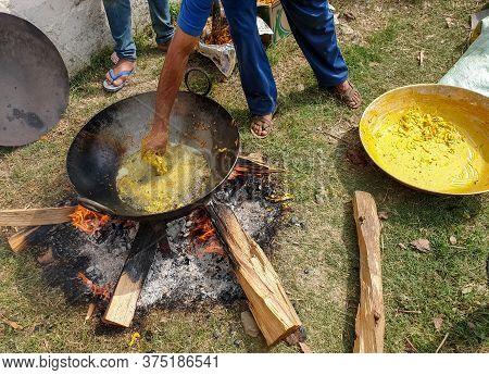 Mandi, Himachal Pradesh / India - June 15 2020: Photo Of Indian People Making Indian Snacks (pakora)