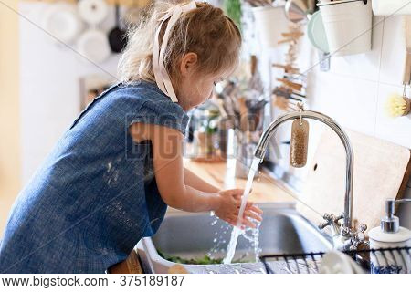 Kid Washing Hands At Home Under Water Tap. Cute Child Girl In Flour After Cooking In Cozy Kitchen. F