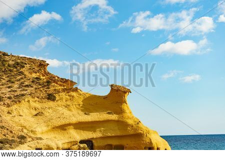 Cocedores Beach With Yellow Sand Formations At Mediterranean Sea, Murcia Region Spain.