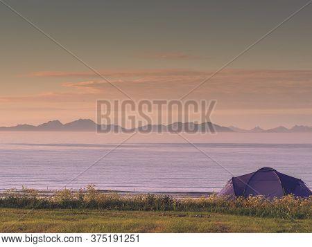 Blue Tent On Gimsoysand Sandy Beach In Summer. Camping On Ocean Shore. Lofoten Archipelago Norway. H