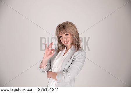 Portrait Of A Woman Business In Suit On A White Grey Background