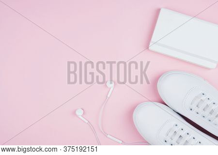 White Classic Style Sneakers, White Earphones And White Copy Book, Flat Lay Style.. Sport Style Conc