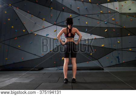 Full Length Shot Of Active Young Woman In Sportswear Going To Climb, Standing Against Artificial Tra