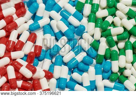 Close Up Of Different Pills, Capsules Lying Randomly. Health Care, Vitamins And Treatment Concept. M