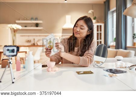 Young Female Blogger Recording A Tutorial Video For Her Beauty Blog About Skincare Routine. Vlogger