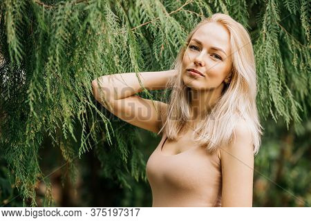 Caucasian Young Blonde Woman Standing Beside Tropical Exotic Plants. Botanic Garden, Rainforest, Vac