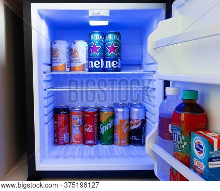 Nakhon Ratchasima, Thailand-june 12,2020: Cold Soda And Beer Cans In Mini Fridge In Hotel Room.