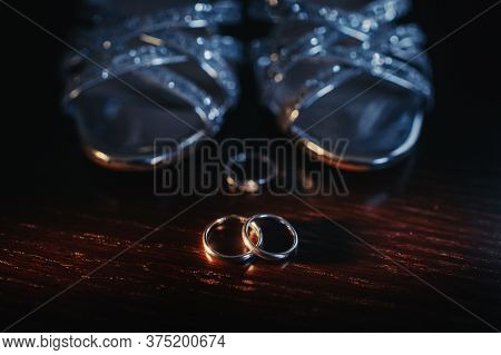 Close-up Of Two Gold Wedding Rings In A Black Background.wedding Ring.wedding Rings