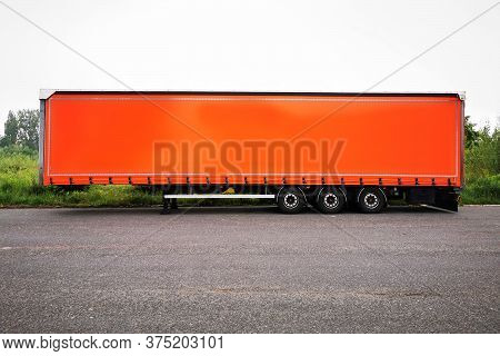 Part Of Orange Truck On The Road