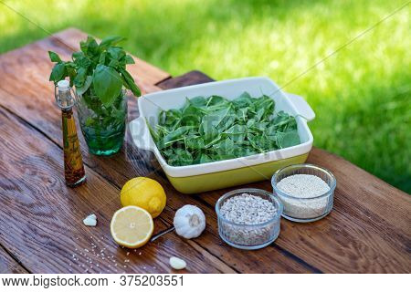 Ingredients For Cooking Snacks From Green Spinach Sauce With Basil, Garlic, Lemon, Sunflower Seeds,