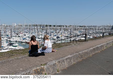 La Rochelle , Aquitaine / France - 11 19 2019 : Port Des Minimes Two Young Woman Look Boat In Summer