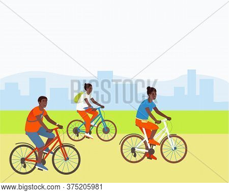 African American Family Rides Bicycles In A Park Outside The City. Mom Daughter And Dad Are Actively