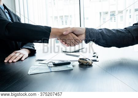 Shaking Hands, Car Dealership Provides Advice About Insurance Details And Car Rental Information And