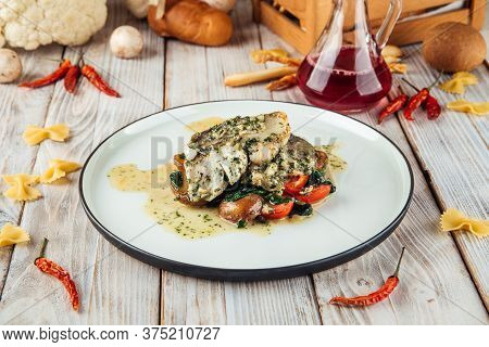 Gourmet Cooked Pike-perch Fish Fillet With Spinach In A Creamy Sauce, Horizontal