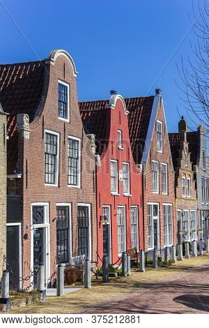 Old Houses With Clock Gable In Harlingen, Netherlands