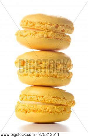 Three Lemon Flavoured Macaroons Standing On Top Of Each Other On White Background.