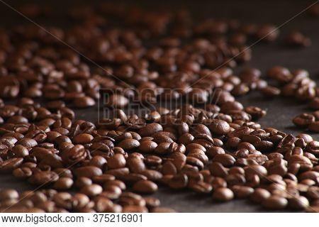 Coffee Beans Close Up In Dark Ground
