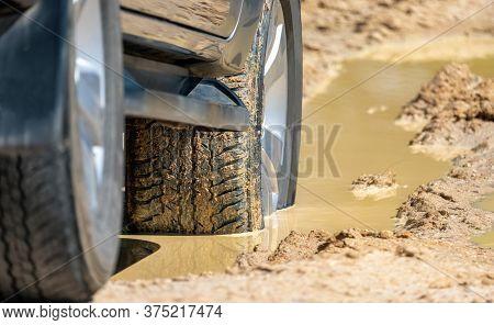 Suv 4wd Car Rides Through Deep Muddy Puddle