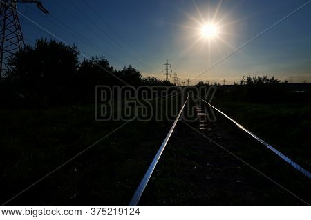 Railway And Beautiful Colorful Sky At Summer Sunset