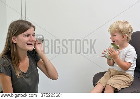 A Boy With Cochlear Implants Playing Tin Can Phone