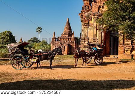 Mandalay, Myanmar - Nov 12, 2019: Horse Buggy At The Ruins Of The Ancient Kingdom Of Ava Amarapura I