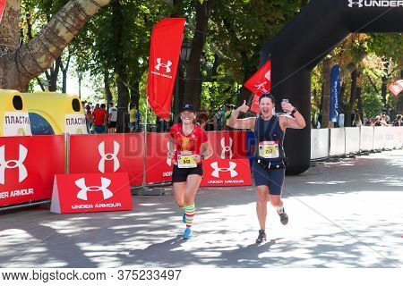 Odessa, Ukraine - Circa September, 2019: Female Marathon Runners Near The Finish Line. Happy Women M
