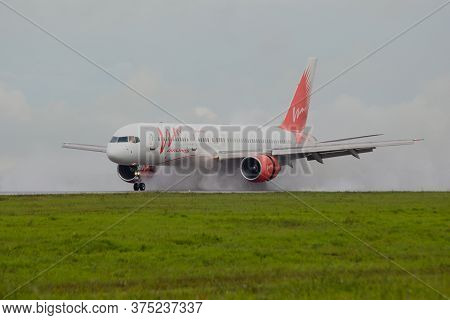 Khabarovsk, Russia-august 24, 2011: A Passenger Plane Landed On A Wet Runway At Novy Airport Uhhh. T