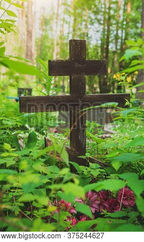 Old Forgotten Grave In The Forest Cemetery.