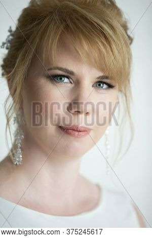 Portrait Of A Fair-haired Blue-eyed Girl. The Face Of A Woman Of European Type.