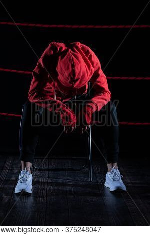 A Lost Fight Of A Strong Mma Player. He Is Sitting In A Chair. Right After Losing The Fight. Sad Wom