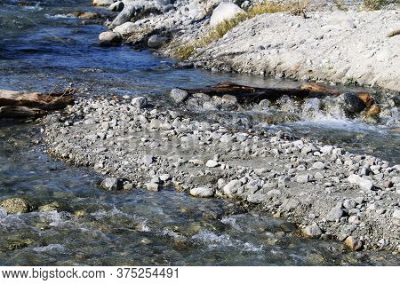 A Clear Flowing Mountain Stream Brook With Rocks Closeup View