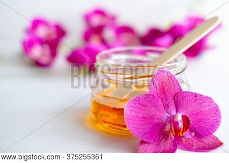 Sugar Paste Or Wax Honey For Hair Removing With Wooden Waxing Spatula Sticks. Flower Background - De