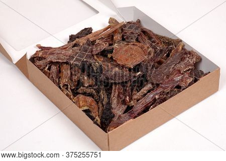 Opened Craft Cardboard Box With Dehydrated Dog Treats, Full Of Dry Meat Crunchy Tastes From Beef And