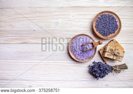 Lavender Spa Products On A Wooden Table, Top View, Copy Space