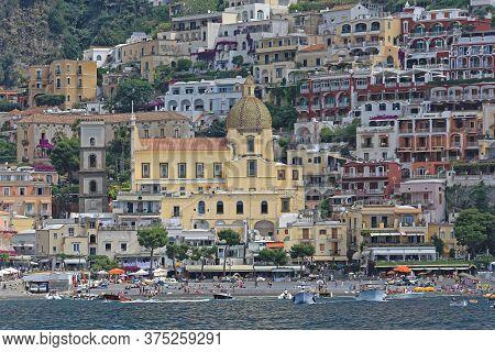 Positano, Italy - June 28, 2014: Church Santa Maria Assunta View From Tyrrhenian Sea In Positano, It