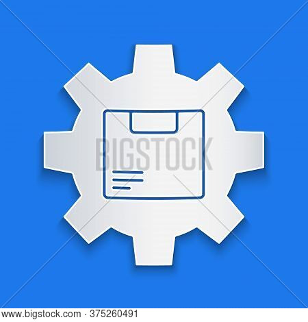 Paper Cut Gear Wheel With Package Box Icon Isolated On Blue Background. Box, Package, Parcel Sign. D