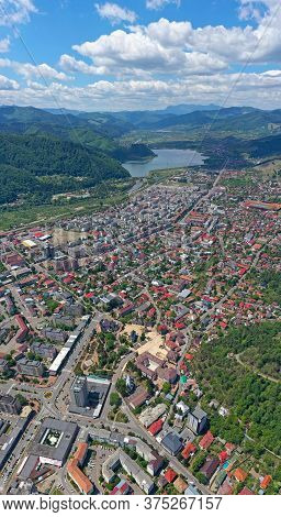 Summer Cityscape Of Piatra Neamt City, Downtown And Bistrita River Valley