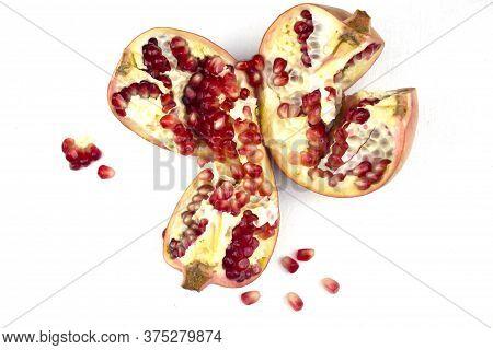 Pomegranates Isolated On White. Big Ripe Red Pomegranate. Pomegranate Isolated On A White Background