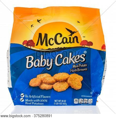 Winneconne,  Wi - 26 June 2020: A Package Of Mccain Baby Cakes Mini Potato Hashbrowns On An Isolated