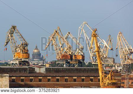 Industrial Landscape With Port Cranes. The Port Of Saint Petersburg, Russia. Port Handling Equipment