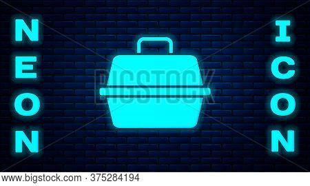 Glowing Neon Pet Carry Case Icon Isolated On Brick Wall Background. Carrier For Animals, Dog And Cat