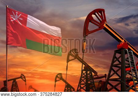 Oman Oil Industry Concept, Industrial Illustration. Oman Flag And Oil Wells And The Red And Blue Sun