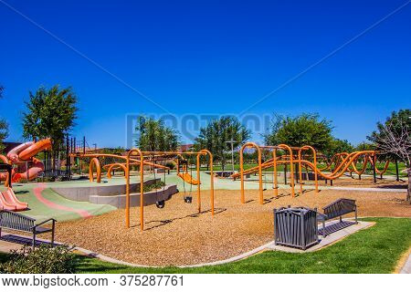 Orange Children's Playground Equipment In Free Public Park