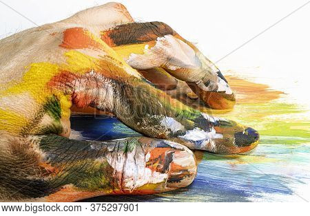 Artist's Hand In Multi-colored Paint. Teznik Hand Drawing. Bright Water-based Paints. Hobbies And Cr