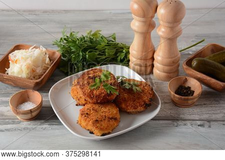 Juicy Fried Homemade Chicken Cutlets. Coated With Breadcrumbs, Delicious, In White Dish With Herbs.