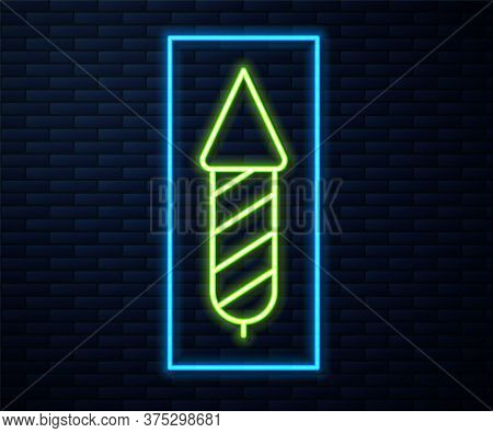 Glowing Neon Line Firework Rocket Icon Isolated On Brick Wall Background. Concept Of Fun Party. Expl