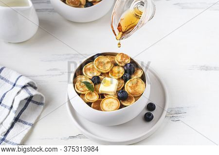 Honey Drops Pouring Over Plate With Pancake Cereal, Trendy Mini Pancakes With Raspberry, Blueberry