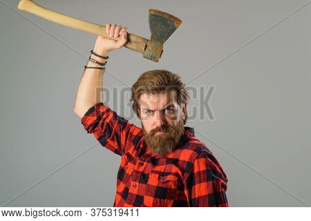 Canadian Lumberjack. Bearded Man With Old Ax. Bearded Man With Old Ax In Hands. Bearded Lumberjack.
