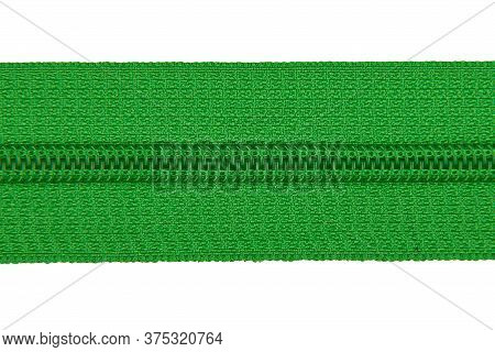 Closed Green Zipper Isolated On White Background. Green Zipper For Tailor Sewing.